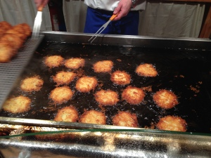 Cooking Riebekuchen - a sort of potato pancake eaten with applesauce- at a Christmas Market in Cologne