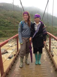 trekking through the mountains and valleys of Sapa in Northern Vietnam with a local Black Hmong hilltribe woman.