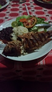 "THIS is a whole fish, cooked just for us. You'll also notice the standard beans and rice, when mixed they are known as ""Gallo Pinto"""