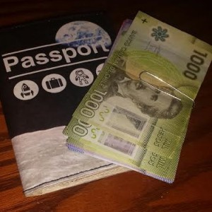 Passport and Chilean currency ready to go