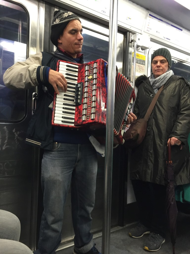 Entertainment on the metro in Paris, France.